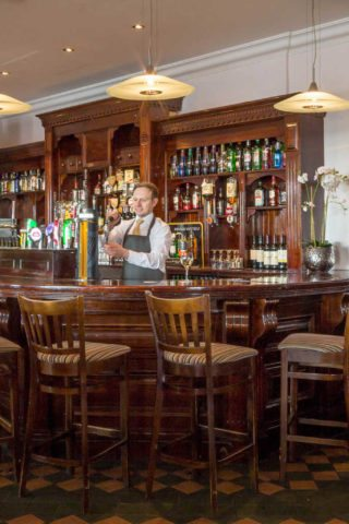 Barman pulling a pint of Guinness in Galway Hotel